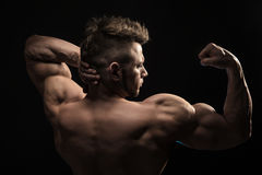 Strong Athletic Man Fitness Model posing back muscles. stock image