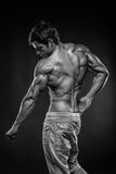 Strong Athletic Man Fitness Model posing back muscles, triceps,. Latissimus royalty free stock photo