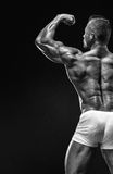 Strong Athletic Man Fitness Model posing back muscles, triceps, Stock Photos