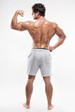 Strong Athletic Man Fitness Model posing back muscles, triceps,. Latissimus over white background royalty free stock image