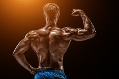 Strong Athletic Man Fitness Model posing back muscles, triceps o Royalty Free Stock Photography