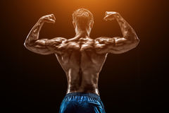 Strong Athletic Man Fitness Model posing back muscles, triceps o Stock Photo