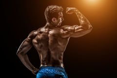 Strong Athletic Man Fitness Model posing back muscles, triceps o Royalty Free Stock Photo