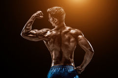Strong Athletic Man Fitness Model posing back muscles, triceps o Stock Photos