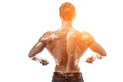 Strong Athletic Man Fitness Model posing back muscles, triceps o stock images