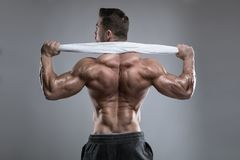 Strong Athletic Man Fitness Model posing back muscles, triceps, Royalty Free Stock Images
