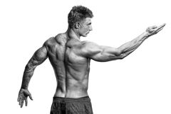 Strong Athletic Man Fitness Model showing muscles Stock Photos