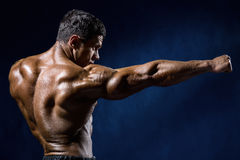 Strong Athletic Man Fitness Model shows the kick Royalty Free Stock Photos