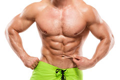 Strong Athletic Man Fitness Model Torso showing abdominal muscle. S without fat isolated over white background royalty free stock images