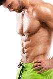 Strong Athletic Man Fitness Model Torso showing abdominal muscle. S without fat isolated over white background royalty free stock photography