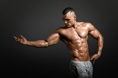 Strong Athletic Man Fitness Model Torso showing big muscles. And exellent abs isolated with clipping path Stock Photo