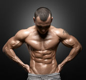 Strong Athletic Man Fitness Model Torso showing big muscles royalty free stock image