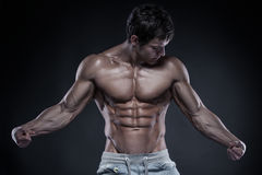 Strong Athletic Man Fitness Model Torso showing big muscles over stock photo