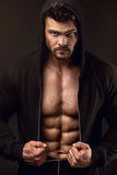 Strong Athletic Man Fitness Model Torso showing big muscles. Over black background Stock Photography