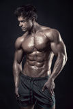 Strong Athletic Man Fitness Model Torso showing big muscles Stock Photography