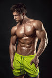 Strong Athletic Man Fitness Model Torso showing big muscles Royalty Free Stock Photography