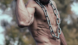 Strong Athletic Man Fitness Model Torso showing. Muscular guy. Fitness Model stock photo