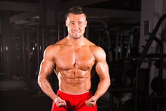 Strong Athletic Man Fitness Model Torso showing six pack abs stock photos