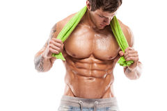 Strong Athletic Man Fitness Model Torso showing six pack abs. Holding towel Stock Image