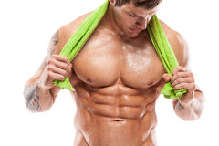 Strong Athletic Man Fitness Model Torso showing six pack abs. Holding towel stock photography