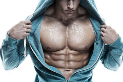 Strong Athletic Man Fitness Model Torso showing six pack abs. is stock photo