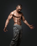 Strong Athletic Man Fitness Model Torso showing six pack abs. On black background with clipping path Stock Images