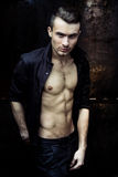 Strong Athletic Man Fitness Model. Torso showing six pack abs on dark background stock images