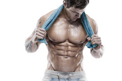 Strong Athletic Man Fitness Model Torso showing six pack abs. Holding towel royalty free stock photos