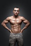 Strong Athletic Man Fitness Model Torso showing six pack abs. Isolated on black background with clipping path Royalty Free Stock Image