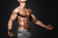 Strong Athletic Man Fitness Model Torso showing six pack abs. Isolated on black background with clipping path Stock Photography