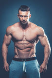 Strong Athletic Man Fitness Model Torso showing six pack abs. is Royalty Free Stock Photography