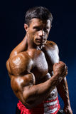 Strong Athletic Man Fitness Model Torso thai boxer showing big m Royalty Free Stock Photography
