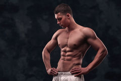 Strong athletic man on grunge background Stock Photography
