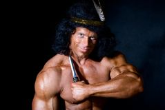 Strong athletic man with a knife Royalty Free Stock Images