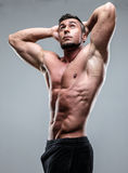 Strong athletic man posing Stock Images