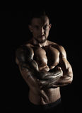 Strong athletic man showes naked muscular body. Strong athletic man. Handsome male fitness model showing naked torso, muscular body. Strong hands, chest and Stock Photo