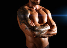 Strong athletic man showes naked muscular body royalty free stock photography