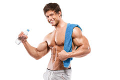 Strong Athletic Man  showing big biceps and abdominal muscles Royalty Free Stock Image