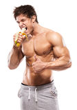Strong Athletic Man  showing muscular body and eating a banana Royalty Free Stock Photography