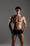 Strong Athletic Man showing muscular body and sixpack abs. Showi Stock Photos