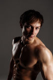 Strong Athletic Man showing muscular body and sixpack abs. Showi Stock Images
