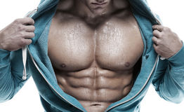 Strong Athletic Man showing six pack abs. closeup Royalty Free Stock Photo