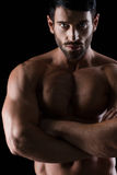 Strong athletic man standing with arms folded Royalty Free Stock Photos