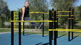 Strong athletic man straight leg raises stock video