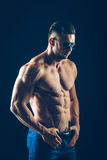 Strong athletic man  in sunglasses on black Royalty Free Stock Image