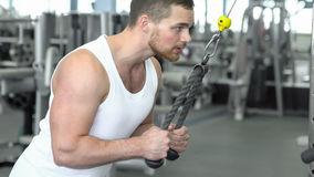 Strong athletic man in a t-shirt at the gym training on block device. Crossfit training. stock photos