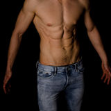 Strong athletic man torso. Before black background Royalty Free Stock Images
