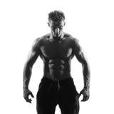 Strong athletic man on white background. Black and white photo strong athletic man isolated over white background Stock Photography