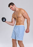 Strong athletic man workout biceps with dumbbell Stock Image