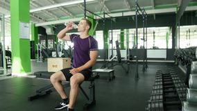 Strong athletic men taking heavy dumbbells for active workout in gym, fitness Royalty Free Stock Photography